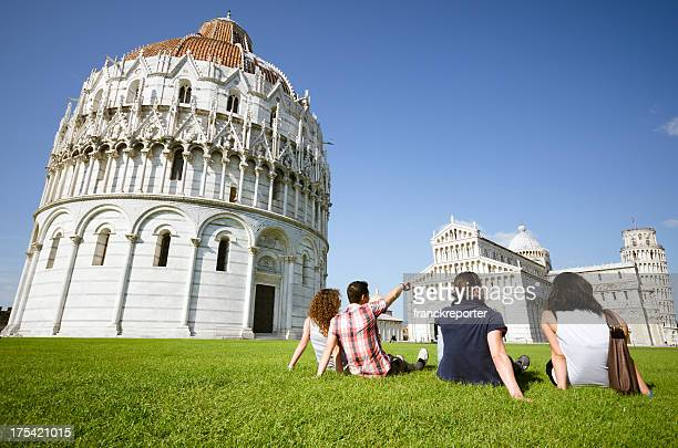 Tourist relaxing and looking the Leaning Tower in Pisa