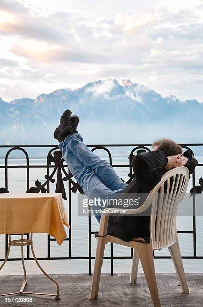 tourist relaxing by amazing view of lake geneva switzerland - vaud canton stock pictures, royalty-free photos & images