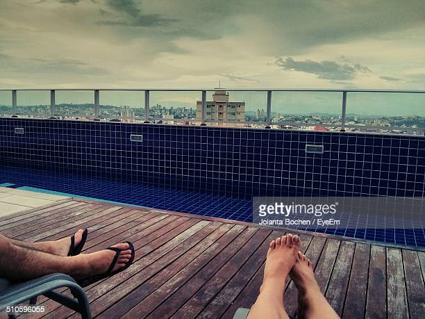 tourist relaxing in resort with cityscape in background - belo horizonte stock pictures, royalty-free photos & images
