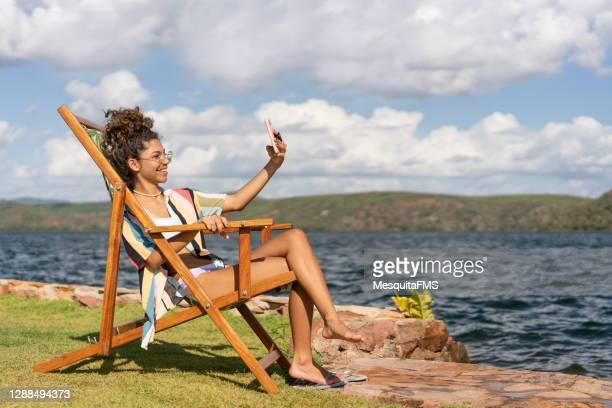 tourist relaxing on the bank of the são francisco river - sentar se imagens e fotografias de stock