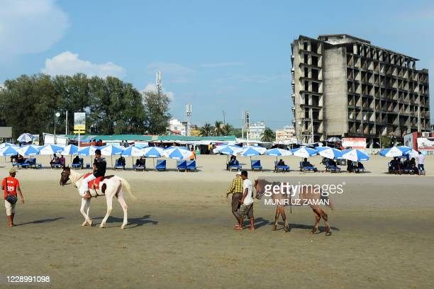Tourist rides a horse on a beach in Cox's Bazar on October 10, 2020.