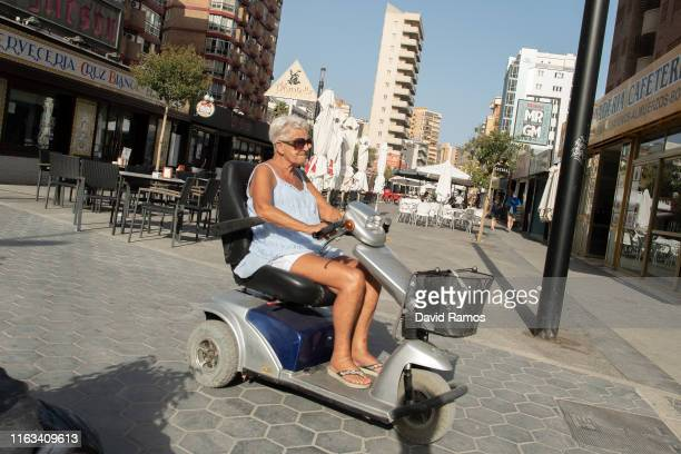 A tourist rides a mobility scooter on July 21 2019 in Benidorm Spain More than 39 million of tourists are expected to visit Spain by the end of July...