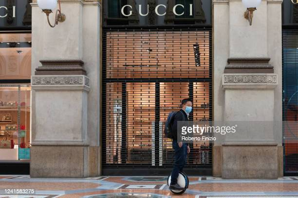 Tourist rides a segway hoverboard as he passes in front of a Gucci store on June 02, 2020 in Milan, Italy. Many Italian businesses have been allowed...