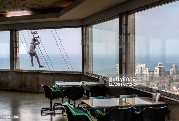 TOPSHOT A tourist rides a zipline from the 55th floor of the observation tower of the Park Beach Resort in Pattaya on February 12 2020 Pattaya Park...