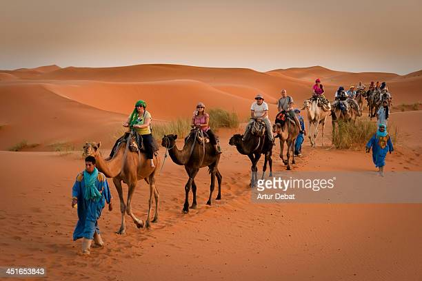 CONTENT] Tourist riding camels on the Erg Chebbi desert a dune region in the Marocaine Sahara desert The crew is leading by a native Berber of the...