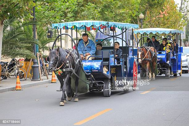 Tourist riding carriage at the Former Foreign concession in Tianjing