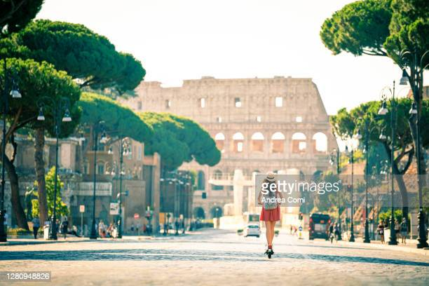 tourist riding electric scooter in rome. italy - rome italy stock pictures, royalty-free photos & images