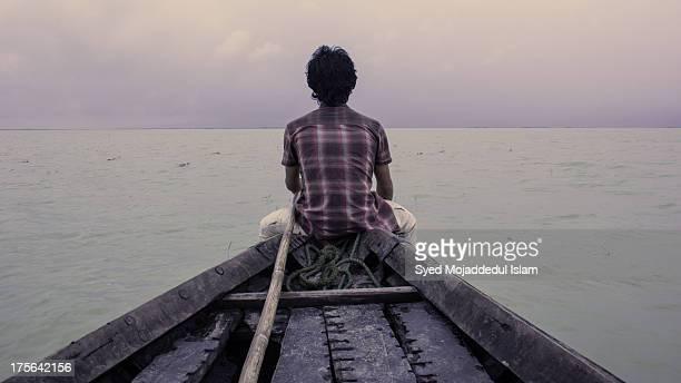 Tourist see towards the horizon at Tangua Haor in Netrokona, Dhaka, Bangladesh.