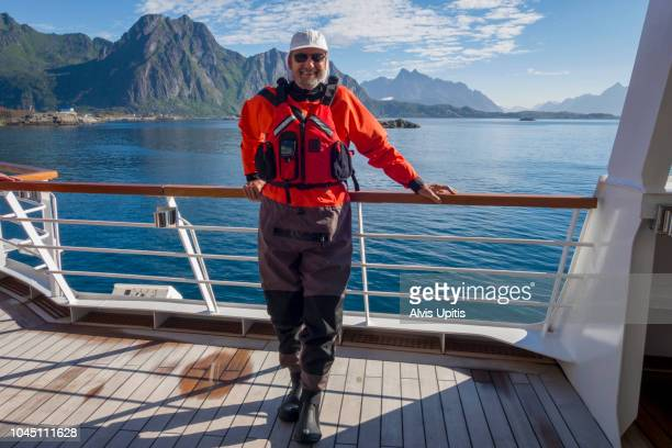 Tourist self portrait about to kayak in Lofoten Islands, Norway
