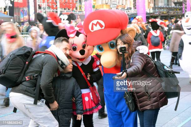 tourist, selfing with costumed characters in times square in manhattan, nyc - disney world stock pictures, royalty-free photos & images