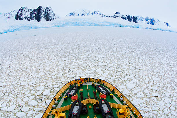 A tourist  Ship in frozen sea, Lemaire Channel