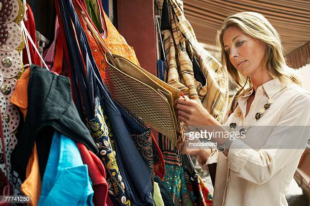 Tourist Shopping for Bags on Stall