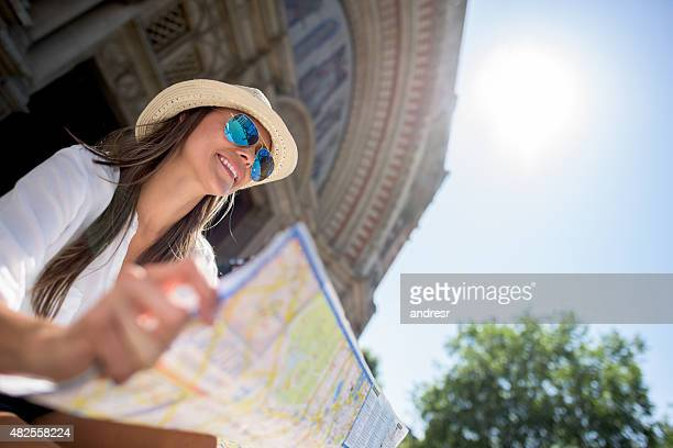 Tourist sightseeing and holding a map