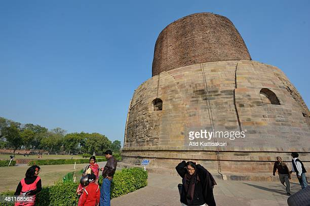 Tourist sightseeing the Dhamekh Stupa in Sarnath The Dhamek Stupa was built in 500 CE by king Ashoka along with several other monuments to...