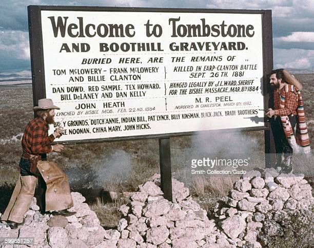 Tourist sign for Tombstone, Arizona and Boothill Graveyard, with list stating that the graveyard is the final resting place of Tom McLowery, Billie...