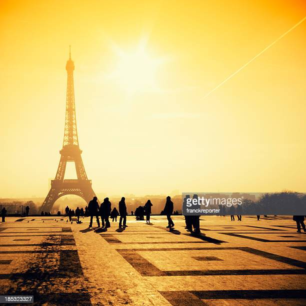 Tourist silhouette in front of Tour Eiffel view against sun