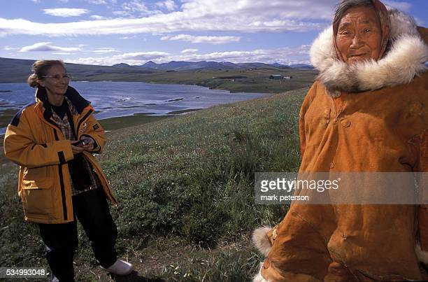 A tourist smiles at a native of the Siberian village of Yanrakynnot made up primarily of Chukchi settlements Tourists aboard the Russian Beaufort Sea...