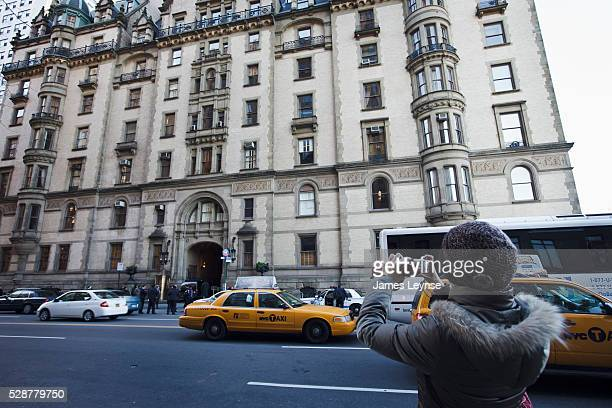 A tourist snaps a photo of The Dakota the famous apartment building on Central Park West where John Lennon once lived