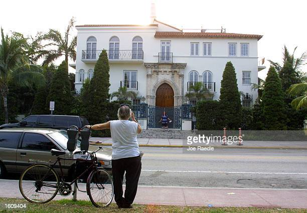 A tourist snaps a picture of Casa Casuarina Gianni Versace''s former residence August 15 2001 in Miami Beach Florida South Beach''s most famous...