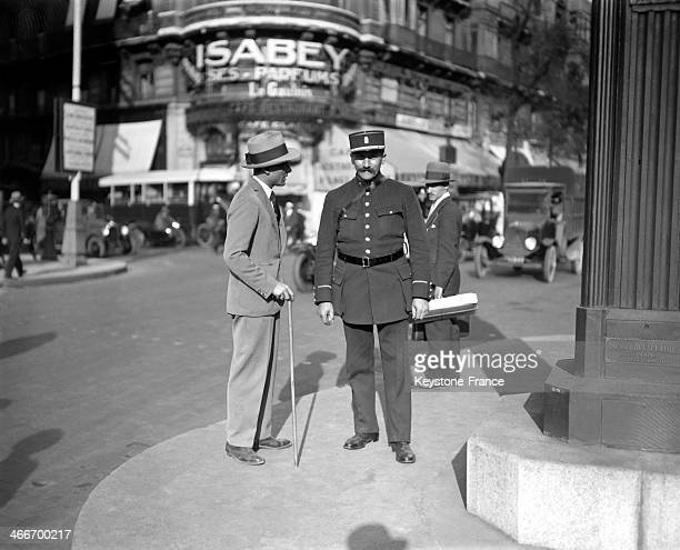 Tourist speaking with policeman in 1928 in Paris France