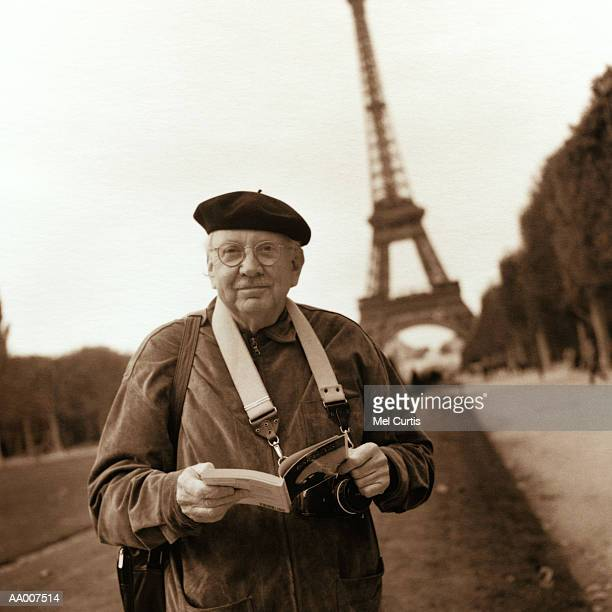 Tourist Standing Below the Eiffel Tower