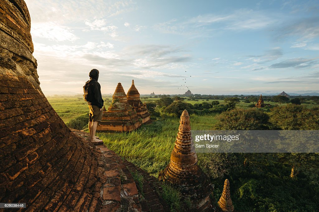 Tourist standing on Bagan Pagoda during sunrise in Myanmar : ストックフォト