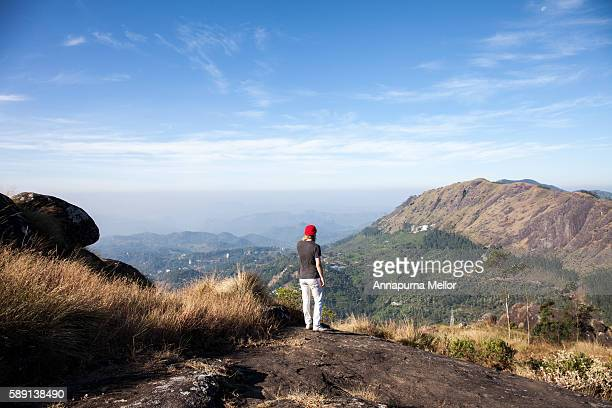 Tourist stands over a view point in Munnar, Kerela, India