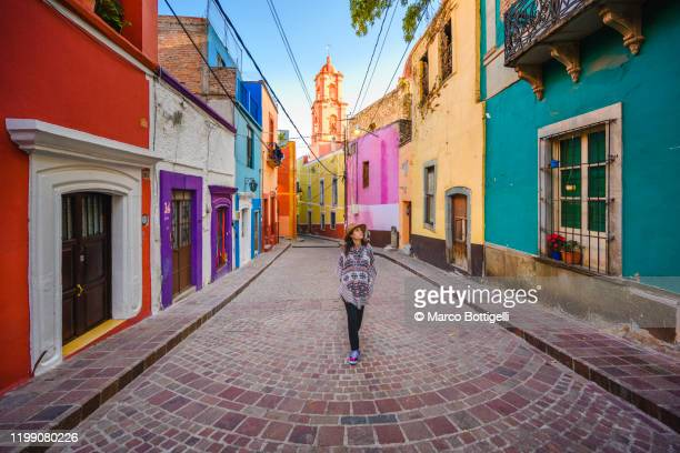 tourist strolling around guanajuato city's old town, mexico - alley stock pictures, royalty-free photos & images