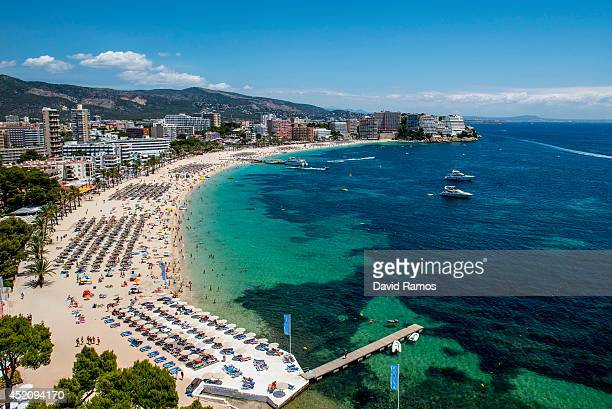 Tourist sunbathe at Magaluf beach on July 13 2014 in Mallorca Spain Magaluf is one of the Britain's favorite holiday destinations popular with sun...