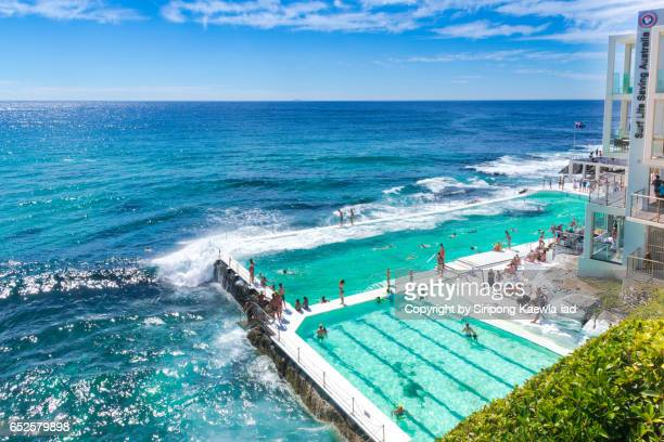 Tourist swimmers are swimming in the Icebergs pool, Bondi beach.