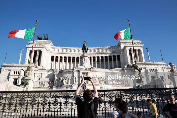 Tourist take a pictures of the Altare della Patria in Roma on July 10 2020 in Roma, Italy.