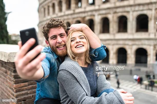 tourist take a self portrait on rome