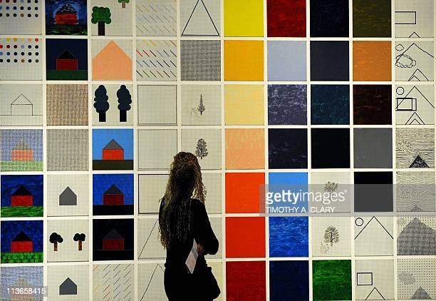 Tourist take avantage of the art and the indoors at the Museum of Modern Art to view Rhapsodya 987steel plate installation by Jennifer Bartlett on...