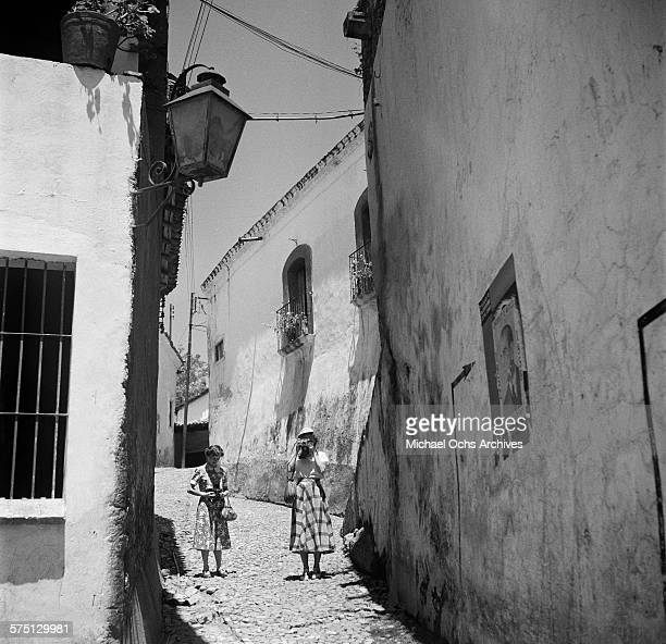 Tourist take photographs down a narrow road in Cuernavaca Mexico