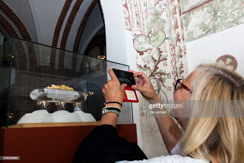 A tourist takes a photo of the model of the sarcophagus originally dedicated Queen Margrethe and Prince Hnerik in Ropskilde Cathedral on August 4, 2017 in Roskilde, Denmark. Danish Prince Henrik announced yesterday that he will not as planned accept to be buried with his wife Queen Margrethe. In an exclusive interview with the Danish daily, BT, royal communication manager Lene Balleby said that the Prince's decision is a consequence of the fact that he has not had equal status to the Queen. The Palace underlines that this does not mean that the Prince would be buried in another country.The sarcophagus has been created by Danish artist Bjoern Noegaard.