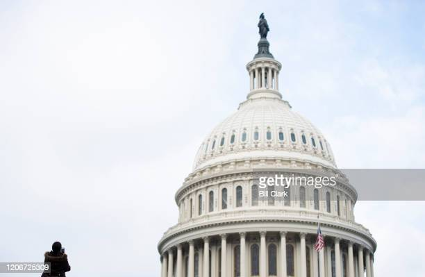 Tourist takes a photo of the U.S. Capitol building on Thursday, March 12, 2020. Tours of the Capitol are expected to be suspended due to the...