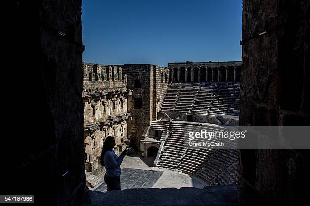 A tourist takes a photograph inside a roman theater of the ancient city of Aspendos on July 12 2016 in Antalya Turkey Russian President Vladimir...