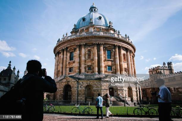 A tourist takes a photograph of the historic Radcliffe Camera library building in Oxford England on June 22 2019