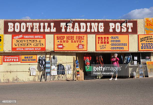 Tourist takes a photograph outside the Boothill Trading Post before walking to the nearby Boothill Graveyard in Tombstone, Arizona. The cemetery, a...