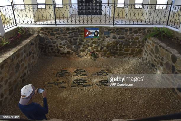A tourist takes a picture of Argentineborn Cuban revolutionary leader Ernesto Che Guevara's mausoleum in Vallegrande southern Bolivia on September 30...