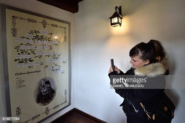 A tourist takes a picture of the family tree of Vlad Tepes in the Bran Castle in Bran Romania on October 18 2016 Armed with courage and hopefully...