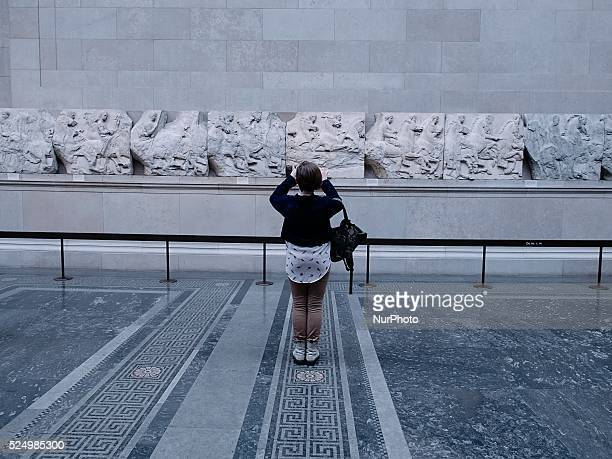 A tourist takes a picture of the Parthenon Marbles The marbles were removed by Lord Elgin and carried from Greece to England