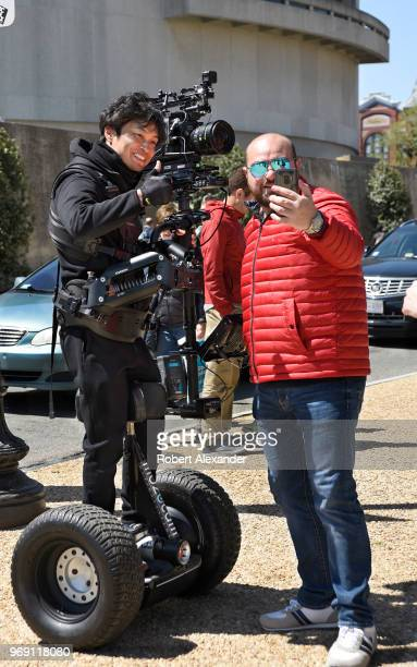 Tourist takes a 'selfie' photograph with a Japanese videographer on assignment in Washington, D.C., shooting a documentary for Japan's NHK television...