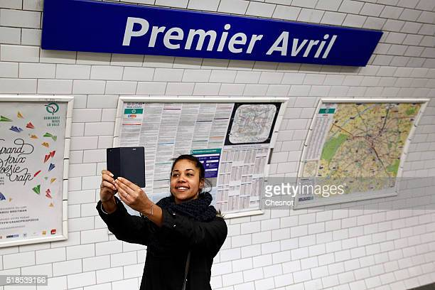 A tourist takes a selfie with the metro station Quatre Septembre which became Premier Avril on April 1 2016 in Paris France For April Fool's Day...