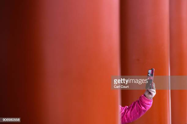 A tourist takes a smart phone photograph at Sensoji buddhist temple on January 19 2018 in Tokyo Japan Sensoji is Tokyo's oldest temple dating back to...