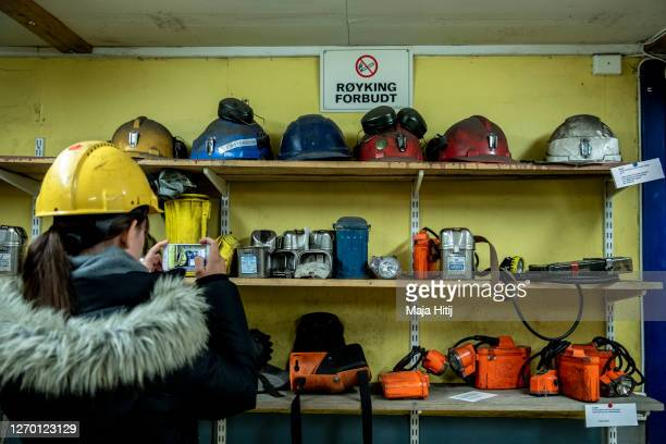 Tourist takes picture in former coal mine number 3 which is home to the Arctic World Archive on Svalbard archipelago on August 26 2020 in...