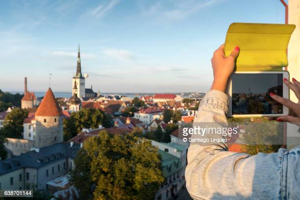 Tourist taking a photo of Tallinn old town skyline