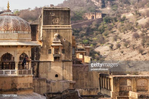 Tourist taking a Photograph from a Balcony at Amer Fort in Jaipur, India