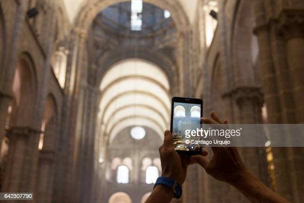 Tourist taking a picture of the interior of Santiago de Compostela Cathedral