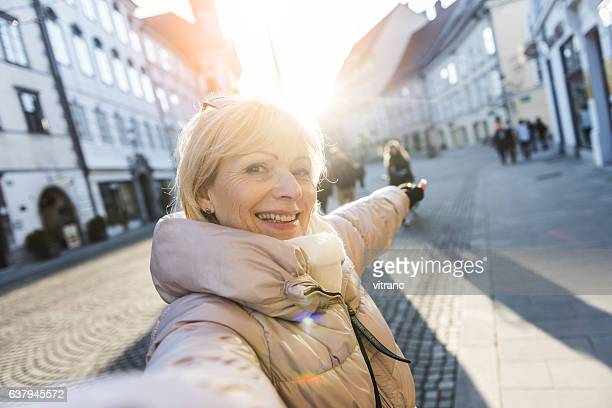 Tourist taking a selfie in Ljubljana, Slovenia